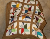 Hand pieced and hand quilted baby quilt.