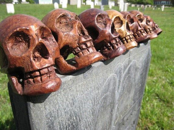 Seven Hand Carved Wood Skulls Each Unique