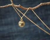 Bezeled pyrite pendant necklace