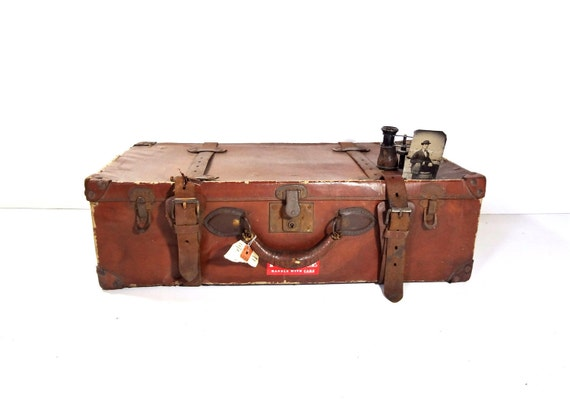 Vintage Brown Suitcase with Leather Straps and Handle