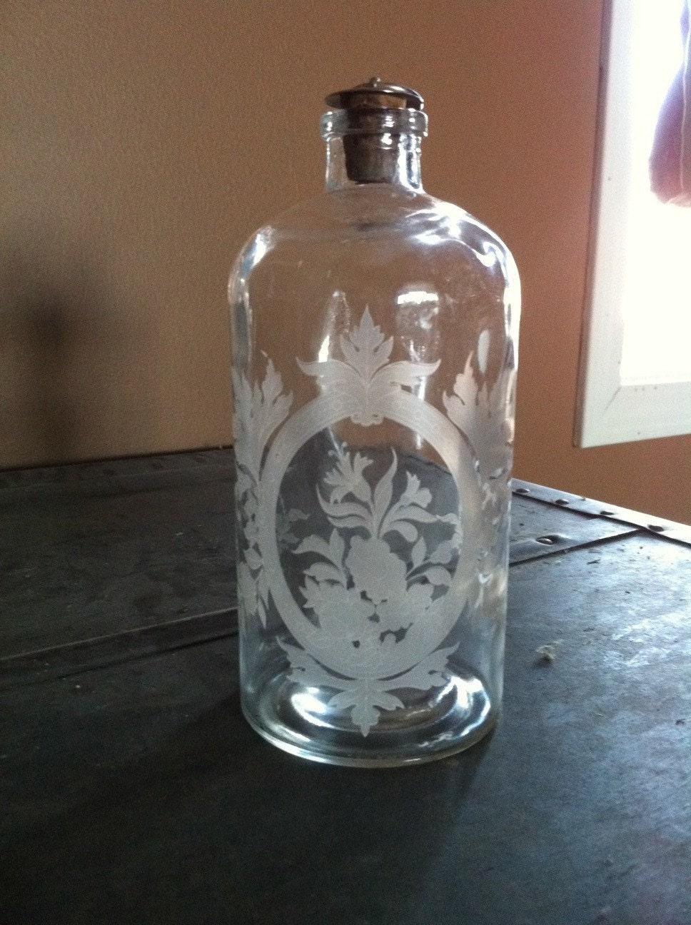 Vintage etched glass bottle