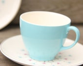 6 Robin's egg blue demitasse teacups and 6 patterned saucers Johnson brothers china
