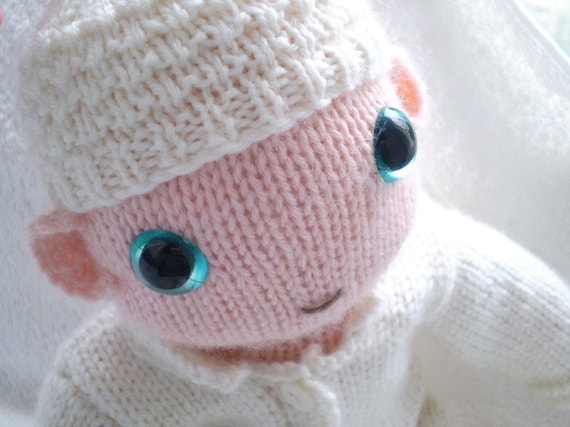 a Knitted sleepsuit for knitted baby