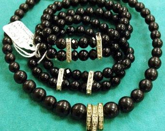Vintage Set of 2 Jet Black Glass Faceted & Smooth Bead, Crystal Rhinestones in Silver Stretch Bracelets