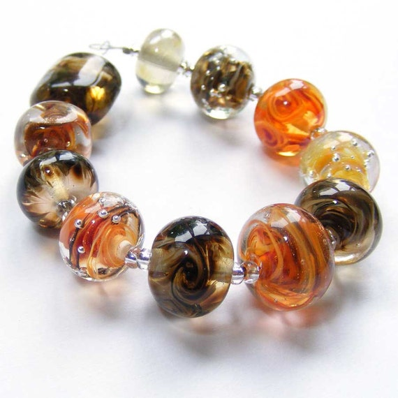 Handmade lampwork glass bead set of multicoloured 11 renegade beads - predominantly orange and brown lampwork orphan beads