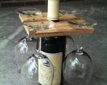 Party of Four hardwood rack for wine bottle and four glasses.  Salvaged wood, 1.99 shipping within U.S.  Great host gift.