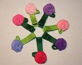 Seven Tiny Rose Bows
