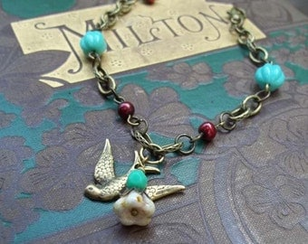 A Bird in the Hand - Turquoise Czech Glass and Sparrow Bracelet