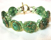 Green Moonglow Vintage Glass Button Bracelet - with gold lustre accents