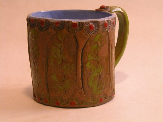 Whimsical mug in green and blue with red