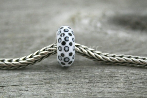 SALE... White or black  big hole bead, cored with sterling silver tubing