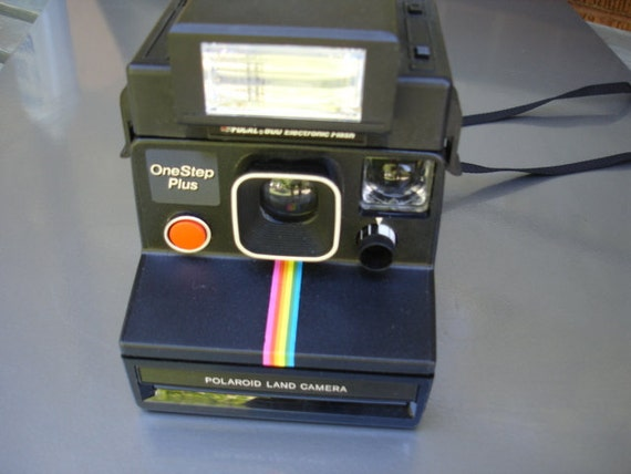 Wow-Polaroid Black Rainbow with Electric Flash- If your looking for a Polaroid Camera see our Entire selection.