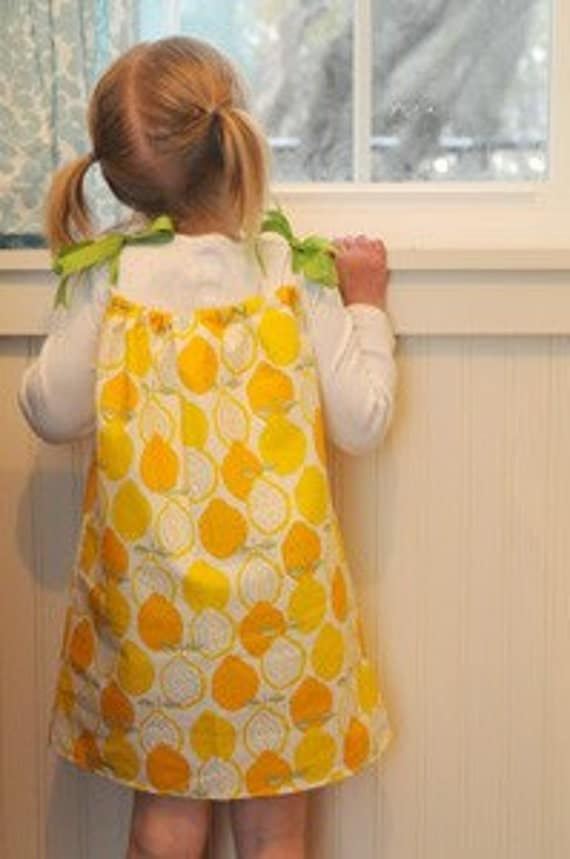 Lemon Designed Pillowcase Dress With Lime-Green Grosgrain Ribbons. Available in Sizes 0 Months-8 Years.