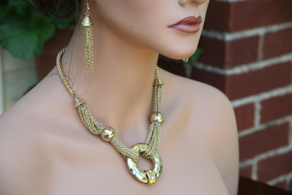 discounted 12 dollars .. Gold pendant necklace with multi strands of gold chain