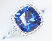 Blue sapphire halo engagement ring or right-hand ring