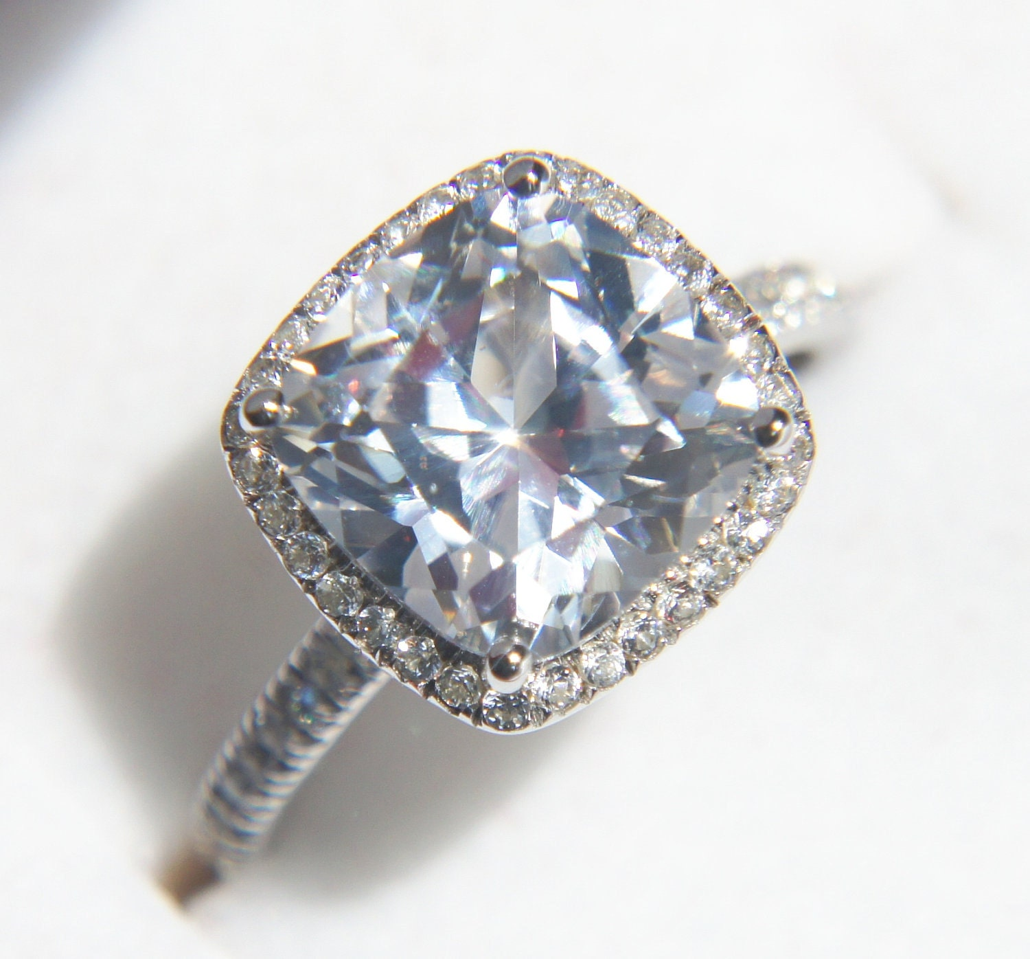 White sapphire halo engagement ring