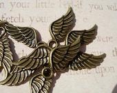 12 Tiny bronze finish WING Charm Drops - Dozen  pieces D.I.Y. Steampunk Pendants