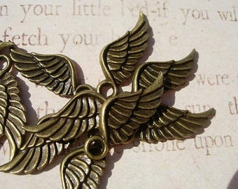 12 Tiny bronze finish WING Charm Drops - Dozen  pieces D.I.Y. Steampunk Pendants