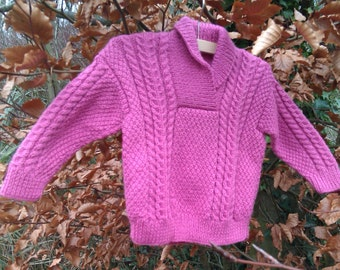 Girl's childs toddlers pink aran cable hand knitted sweater with shawl neck collar