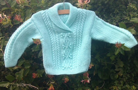Child's boy girl toddler handknit pale green aran cable sweater with shawl collar.