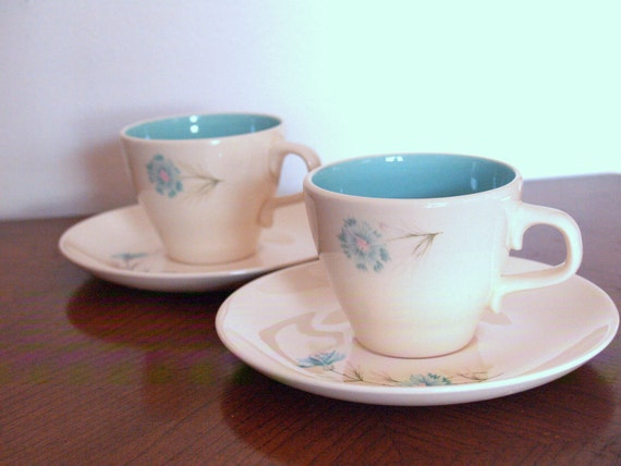 2 teacups with saucers.  Floral accent.  Really sweet. Off white.  Aqua.