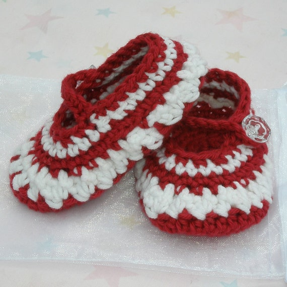 Baby girl crocheted shoes mary janes ruby red and white in colour.
