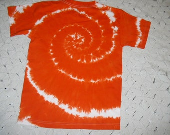 Tie dye shirt,  youth larges available for shipment today-  All other sizes will be shipped within a week , Orange and white swirl