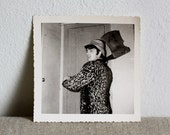Vintage French Photograph chopping wood in a leopard coat 1965