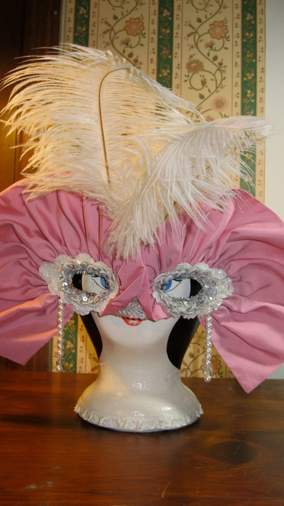 Fanciful pink mask with White Feathers