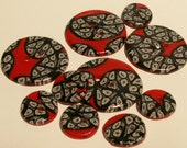 Red and black polymer buttons