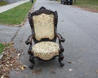 Antiqe oak ornate carved arm chair