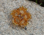 Golden yellow flower accent hairclip in beads and crystals