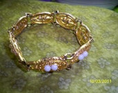 Circa Late 1900s Sarah Coventry Soft Swirl Bracelet with White Beads - Goldtone