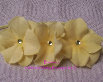 Simply the sweetest triple flower headband, layers of soft petals adorned with dainty rhinestone centers.