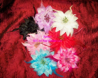 Organza Flowers with Glitter and Accented with Feathers.  Available in Red, Lavender, Black, White, Turquoise, Pink and Hot Pink
