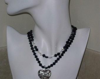 2 strand Glass Swirl Heart Pendant necklace (item 5611)
