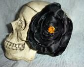 Black satin flower hair clip with glass pumpkin bead