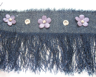 VINTAGE DENIM FRINGES with purple flowers and silver eyelets.