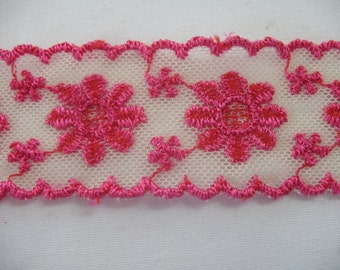 VINTAGE LACE TRIM embroidered in purple and fuchsia .