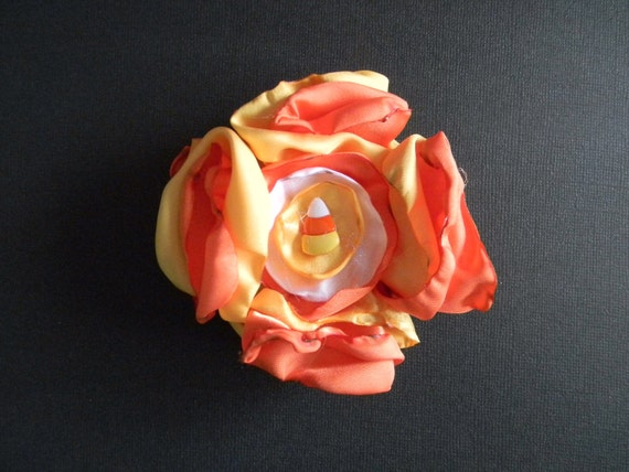 Cute Fall or Halloween candy corn stacked flower/rosette hair clip or brooch.