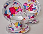 A Pair Of Upcycled, Hand-Drawn Geometric Patterned Tea Cups And Plates