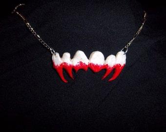 Bloody fangs pendant