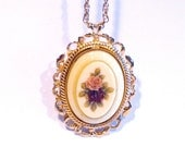 Victorian Style Necklace with a lavender purple flower on the front