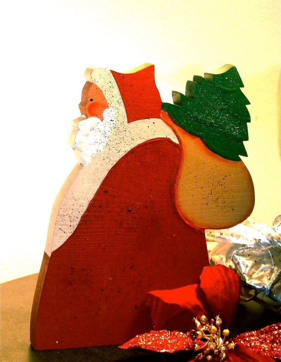 Wooden Santa With Toy Sack on His Back in Red White Green and Brown