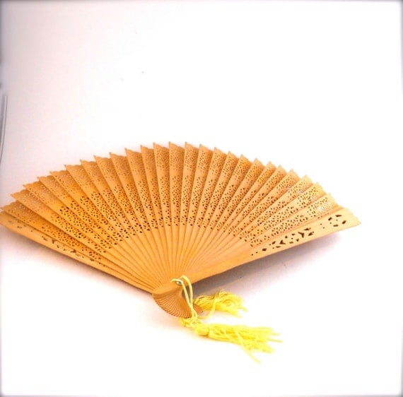 Vintage Folding Hand Fan made of Wood.  Lacy cut out pattern