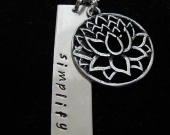 Simplify necklace with lotus flower charm