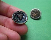 Antique metal picture buttons strawberry and clown