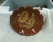 A redware pie plate reproduction by Westmoore pottery Seagrove NC