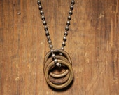 Three Brass Rings necklace.