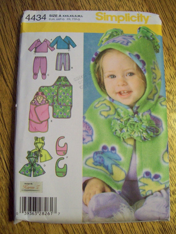 UNCUT Sewing Pattern - BABY Wrap Top, Cape with Fringe Ears, Footie Pants and Blanket Wrap - Size XXS - L - Simplicity 4434